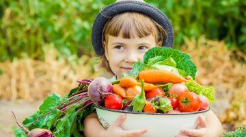 Child with vegetables